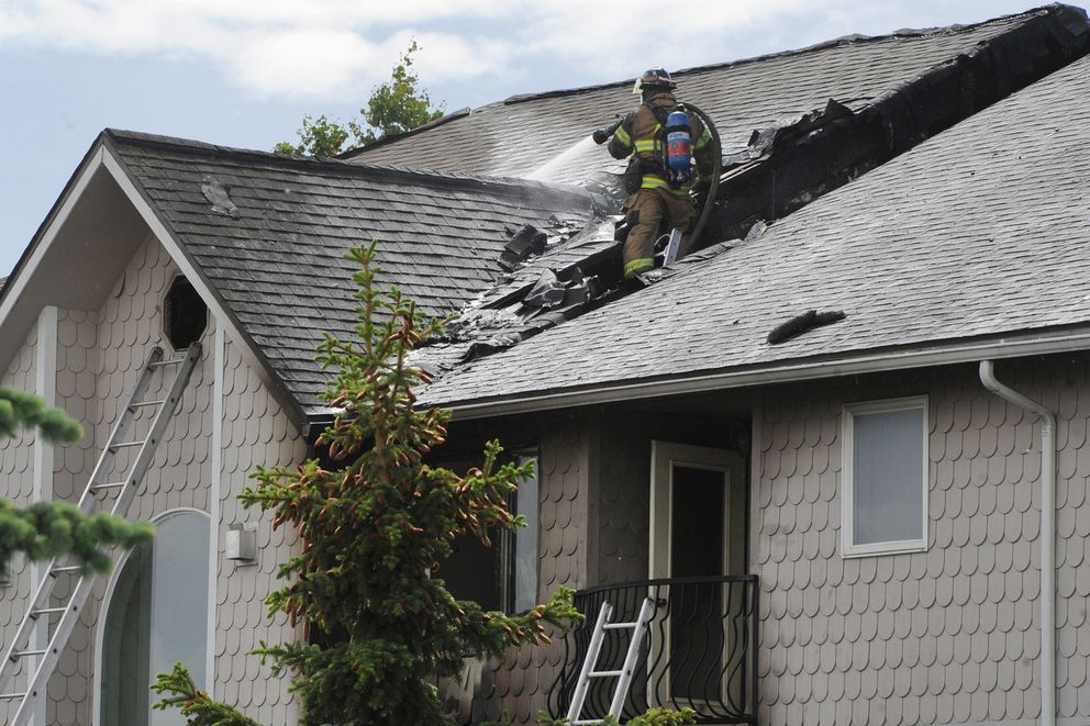 Anchorage firefighters responded to a structure fire in apartment homes off West 26th Avenue in Spenard on Wednesday, June 24, 2020. (Bill Roth / ADN)