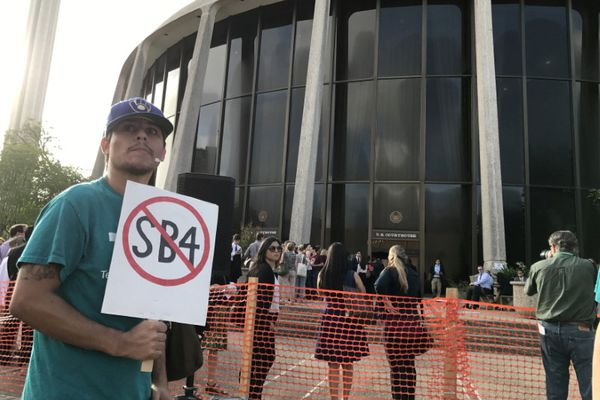A protester against the Texas state law to punish