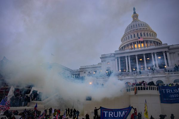 Tear gas fired by police billows around supporters of President Donald Trump as they attack the U.S. Capitol on Jan. 6. MUST CREDIT: photo for The Washington Post by Evelyn Hockstein.