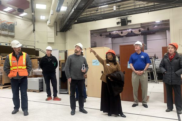Rep. Sharon Jackson points to a section of roof in the multipurpose room at Gruening Middle School during a walk-through of the school held for community members on Thursday, Dec. 19, 2019 in Eagle River. School district officials and engineers conducted a tour of the building to show areas in need of repair and detail upgrades that will be made to the facility, which was damaged in the Nov. 30, 2018 earthquake. (Matt Tunseth / ADN)