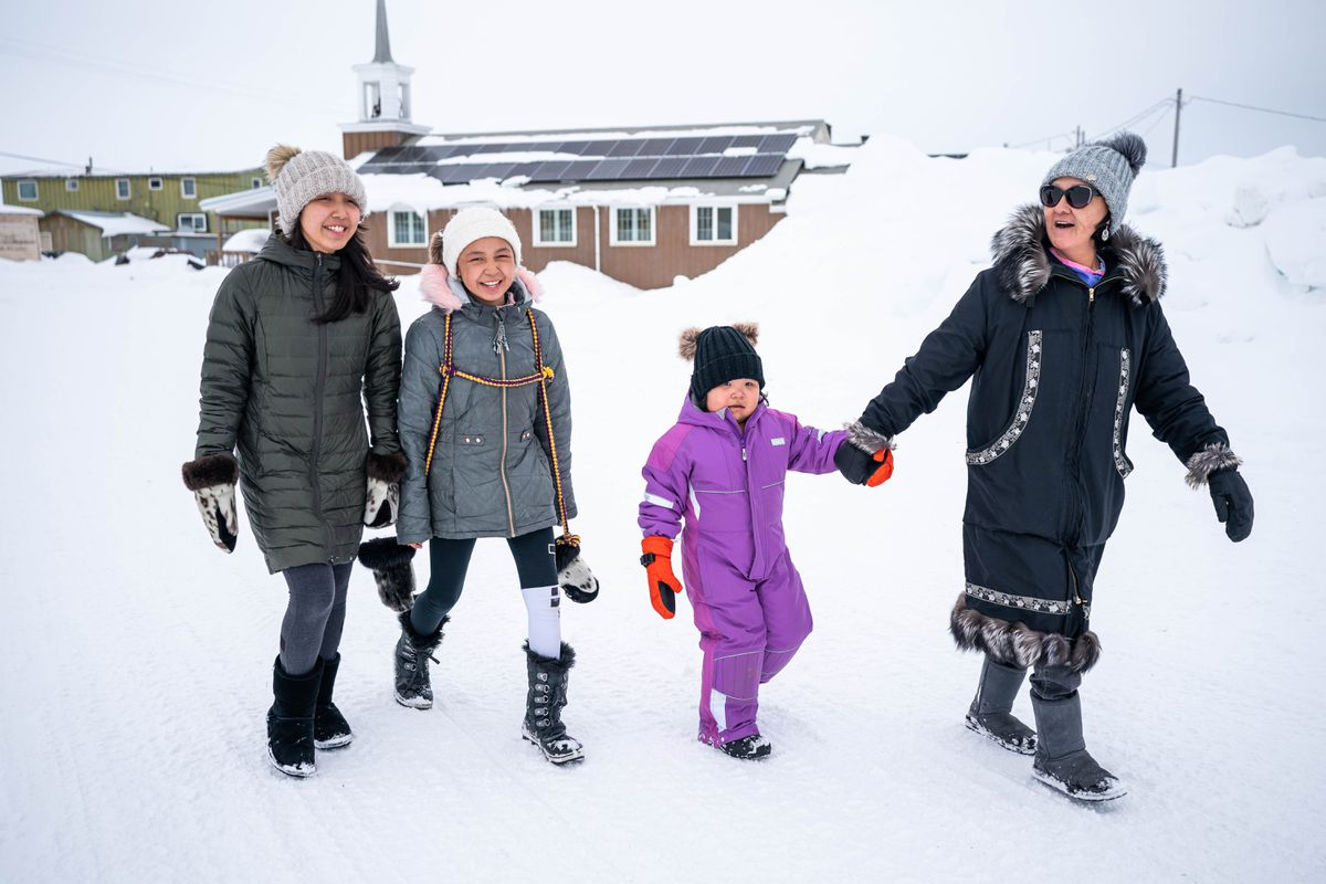 From left, Rebecca Amarok, 13, Bailey Amarok, 12, Karmen Olanna, 4, and Virginia Olanna walk to the store in Unalakleet on Monday, March 16, 2020. Virginia and her family recently moved to Unalakleet from Golovin. (Loren Holmes / ADN)
