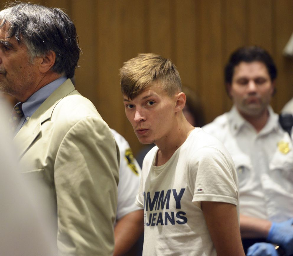 Volodymyr Zhukovskyy, 23, of West Springfield, stands during his arraignment in Hampton District Court, Monday, June 24, 2019, in Springfield, Mass. Zhukovskyy, the driver of a truck in a fiery collision on a rural New Hampshire highway that killed seven motorcyclists, was charged Monday with seven counts of negligent homicide. (Don Treeger/The Republican via AP, Pool)