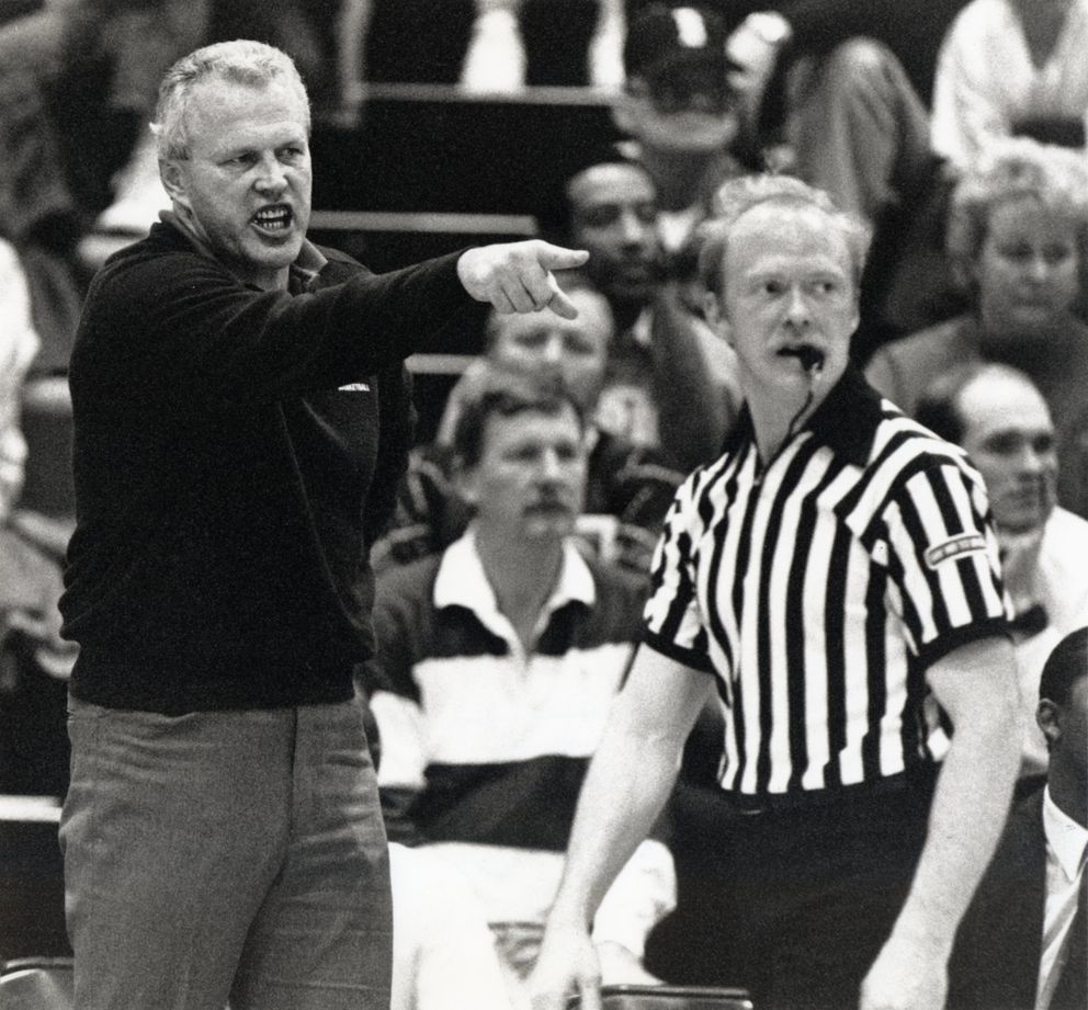 Coach Chuck White shouts instructions to his East team in a December 1990 game against West at the East High School gym. (PAUL SOUDERS / Anchorage Daily News)