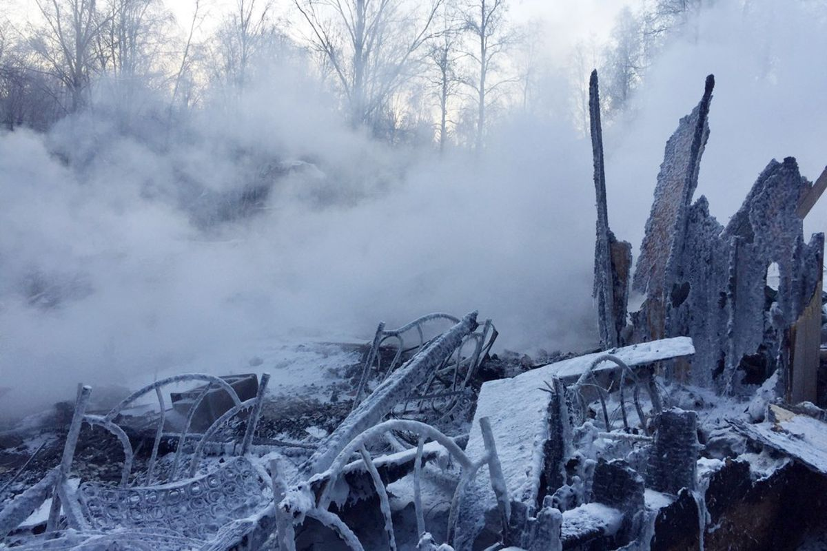 The home of Bill Peterson smoldered Thursday morning following a fire that destroyed the building Wednesday evening in Bird Creek. No one was injured in the blaze. (Robyn Peterson)