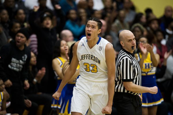 Power forward Kamaka Hepa celebrates his Jefferson High School team's play in front of a capacity crowd at the school on February 16, 2018. (Marc Lester / ADN)