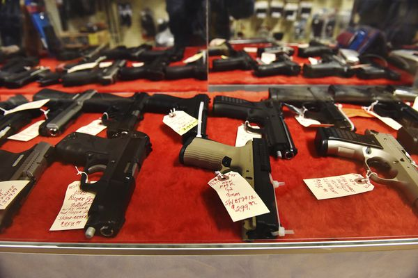 Handguns sit in a display case at Nimrod Haven Hunting & Fishing in Hanover Township near Wilkes-Barre, Pa., Wednesday, March 18, 2020. Pennsylvania's state-run background check system for gun purchases processed more than 4,300 transactions on Tuesday, about three times its typical daily rate. State police said Wednesday the numbers were high even though the system had two computer outages of more than three hours apiece on Tuesday. (Sean McKeag/The Citizens' Voice via AP)