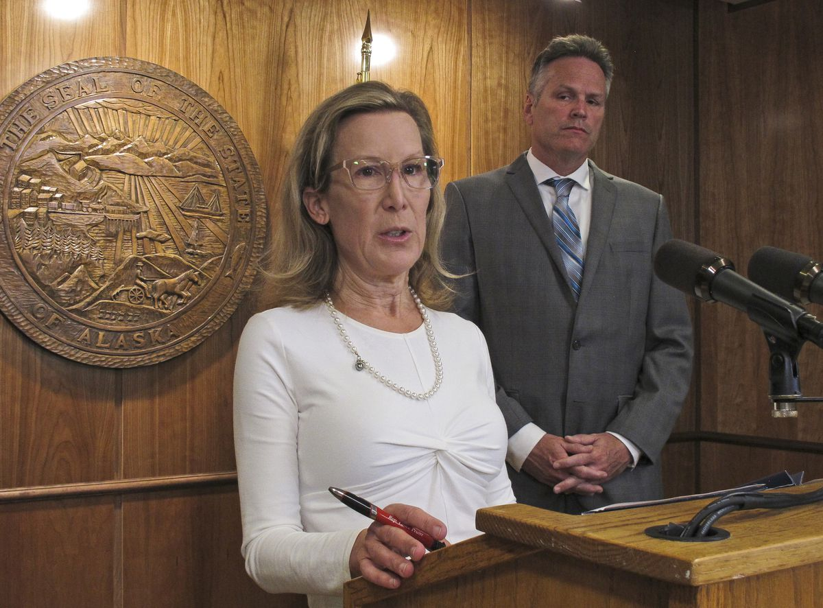Donna Arduin, director of the Office of Management and Budget, talks about on the governor's state budget vetoes in June, with Alaska Gov. Mike Dunleavy. Friday, June 28, 2019 (AP Photo/Becky Bohrer)