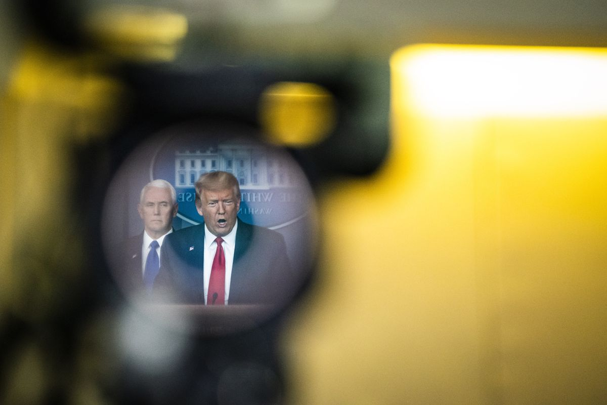 President Trump, reflected in a television camera, speaks with his coronavirus task force at a White House briefing on March 18., 2020. Washington Post photo by Jabin Botsford.