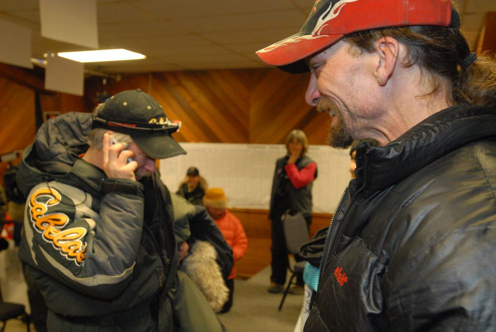 Iditarod musher Jeff King finished in second place early March 12, 2008, crossing under the burled arch in Nome. King talks to Lance Mackey's dad Dick Mackey, iditarod winner, and tells him about the old musher trick Lance Mackey pulled on him in Elim to seal Mackey's win. (Bob Hallinen / ADN archive)