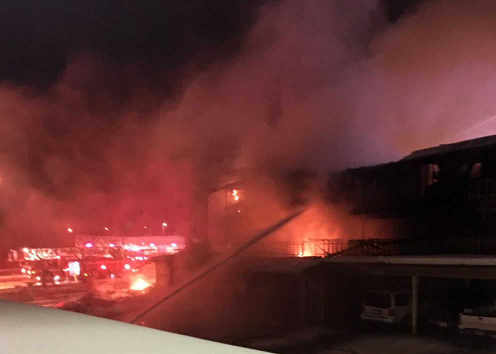 Water is poured into the flaming Royal Suite Apartments 50 minutes after fire was reported at the structure early Wednesday morning. (Ceara Streisel)