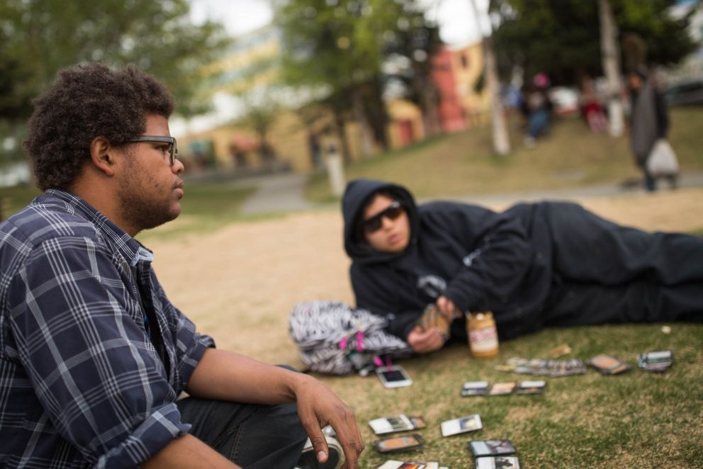 "Donte Thornton, left, and Harmony Toves play Magic the Gathering in Town Square Park on May 6, 2016. ""There's a lot of people who play down here so you can always find a game,"" said Thornton. (Loren Holmes / Alaska Dispatch News)"
