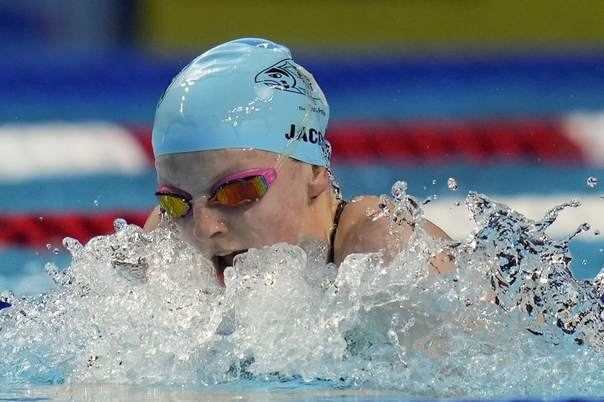 Lydia Jacoby of Seward, seen here winning her semifinal heat on Monday, placed second in Tuesday's 100-meter breaststroke finals to clinch an Olympic berth. (Jeff Roberson / Associated Press)