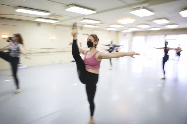 Ashlinn Tuning warms up alongside classmates during the Studio Pulse Competition Team dance practice at Studio Pulse in Anchorage on July 15, 2020. (Emily Mesner / ADN)