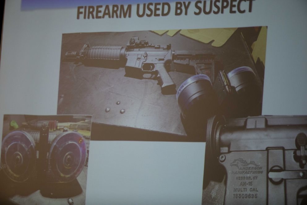 The firearm used by the shooter Connor Betts, 22, is projected on a screen during a press conference Sunday, Aug. 4, 2019, about a mass shooting that left left multiple people dead and 26 injured along the 400 block of E. Fifth Street, in Dayton, Ohio. (Albert Cesare/The Cincinnati Enquirer via AP)