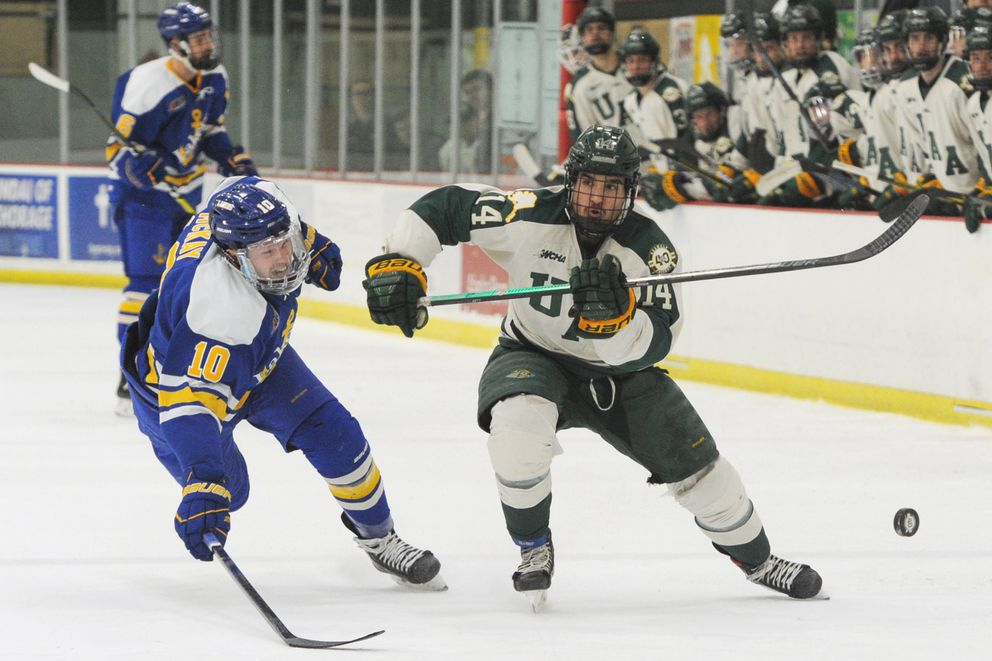 UAA sophomore center Jared Nash brings the puck down ice against Lake Superior State forward Brendan McKay. (Bill Roth / ADN)
