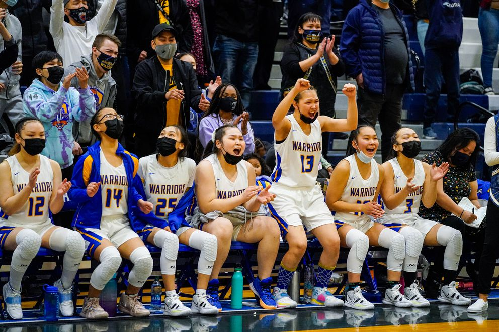 The Warriors react to a successful free throw attempt late in the game. (Loren Holmes / ADN)