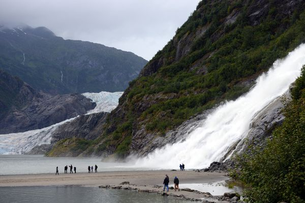 Water gushes down Nugget Falls as visitors make a short hike to the cataract adjacent to Mendenhall Glacier on Monday, August 14, 2017, in Juneau. (Erik Hill / Alaska Dispatch News)