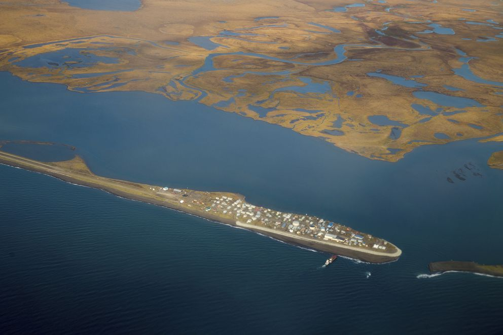 FILE - This Sept. 2, 2015, file aerial image shows the island village of Kivalina, an Alaska Native community of 400 people. Northern Alaska coastal communities and climate scientists say sea ice disappeared far earlier than normal this spring and it's affecting wildlife. The Anchorage Daily News reported in June 2019 that ice melted because of exceptionally warm ocean temperatures. (AP Photo/Andrew Harnik, File)