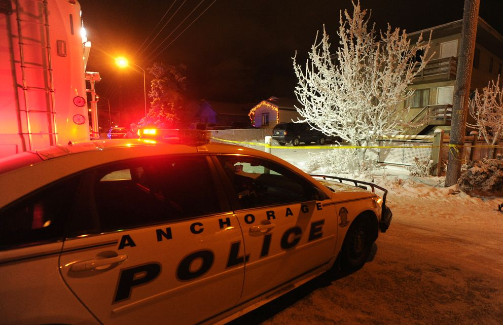 Anchorage police investigate a homicide at the 4100 block of Peterkin Avenue in Mountain View in Anchorage on Saturday. Police indicated that two people were dead at the scene. (Bob Hallinen / Alaska Dispatch News)