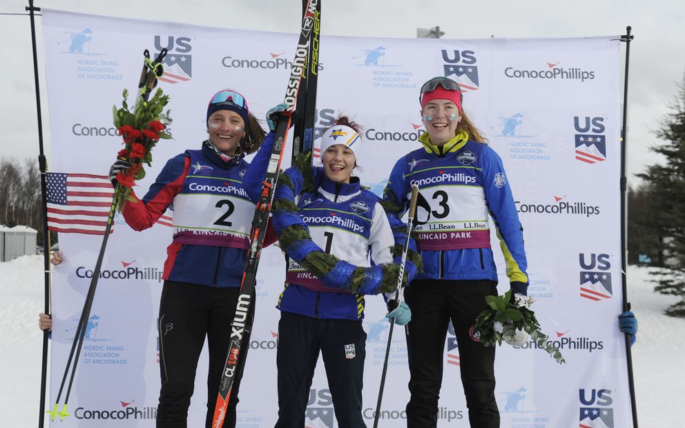 Kendall Kramer, center, celebrates her gold medal. Flanking her are silver-medalist Sarah Morgan, left, and bronze-medalist Charlotte Ogden. (Photo by Michael Dinneen)