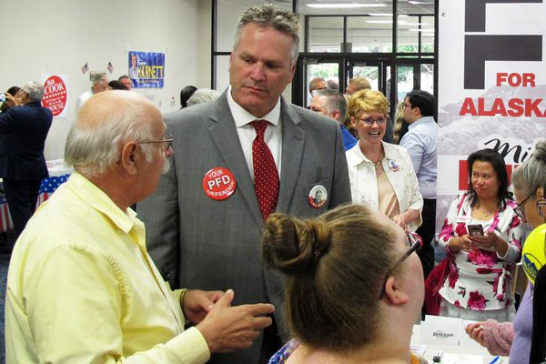 FILE - In this Aug. 19, 2018 file photo, Republican gubernatorial candidate Mike Dunleavy, second from left, stands near his campaign table at a meet-and-greet event in the lobby of Anchorage Baptist Temple in Anchorage, Alaska. As a kid growing up on the East Coast, Mike Dunleavy dreamed of coming to Alaska, of hunting caribou, fishing in wild streams and losing himself in the state's vast, open spaces. Now, after nearly 35 years in his adopted state, the conservative Republican is vying to become Alaska's next governor. (AP Photo/Becky Bohrer, File)
