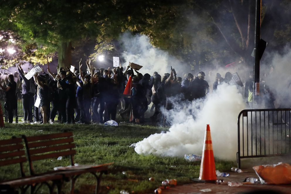 Tear gas billows as demonstrators gather in Lafayette Park to protest the death of George Floyd, Sunday, May 31, 2020, near the White House in Washington. Floyd died after being restrained by Minneapolis police officers (AP Photo/Alex Brandon)