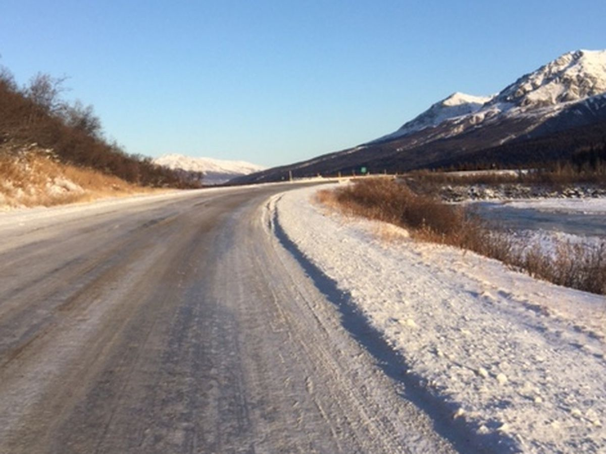 Snow appears on the road near Miller Creek by Mile 217 on the Richardson Highway. (Photo by John Schandelmeier)