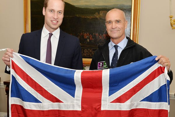 Former Army officer Henry Worsley with Britain's Prince William as they hold the British flag in London. Worsley has died after suffering exhaustion and dehydration while attempting to cross the Antarctic alone.