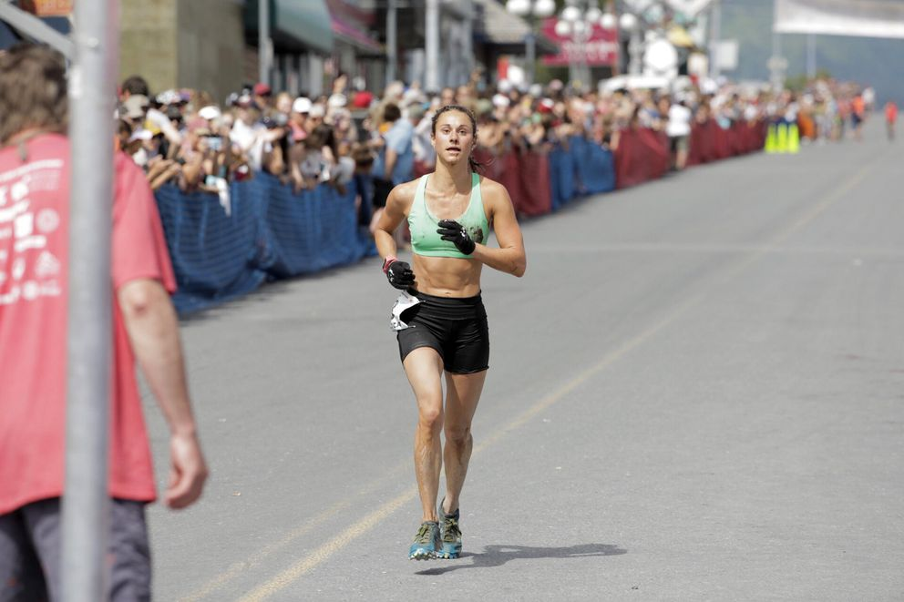 Jessica Yeaton is meters away from victory in the women's race. (Loren Holmes / ADN)