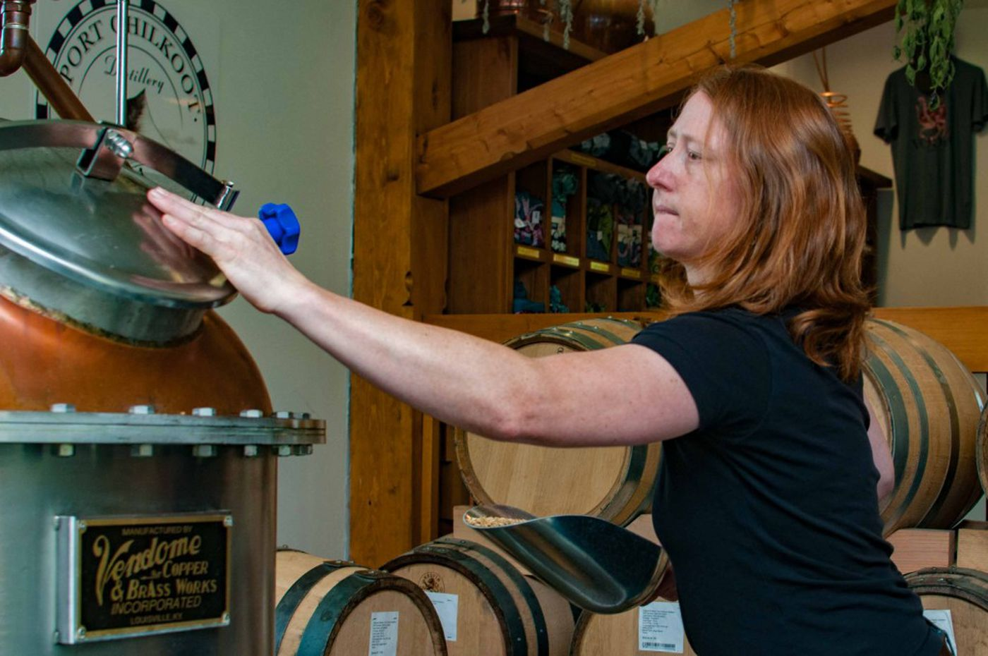 Heather Shade at work, Port Chilkoot Distillery, Haines, Alaska. (Photo by Andy Hedden)
