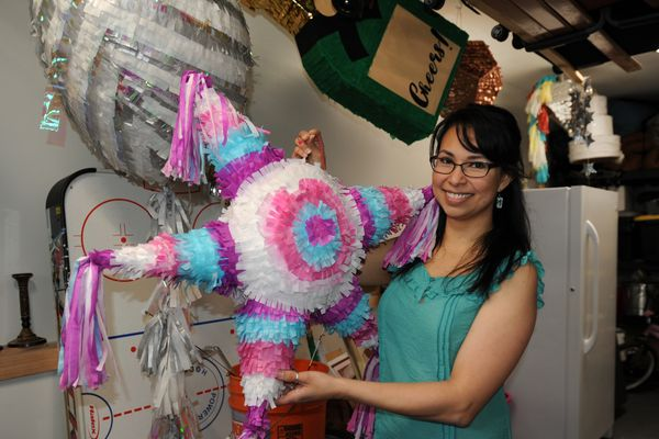 Carolina Vidal holds a piñata on Wednesday, March 7, 2018, that she made in her South Anchorage home. Vidal started The Piñata Shop less than a year ago to create