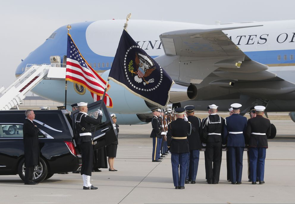 The flag-draped casket of former President George H.W. Bush is carried by a joint services military honor guard during a departure ceremony at Andrews Air Force Base, Md., Wednesday, Nov. 5, 2018. (AP Photo/Steve Helber)