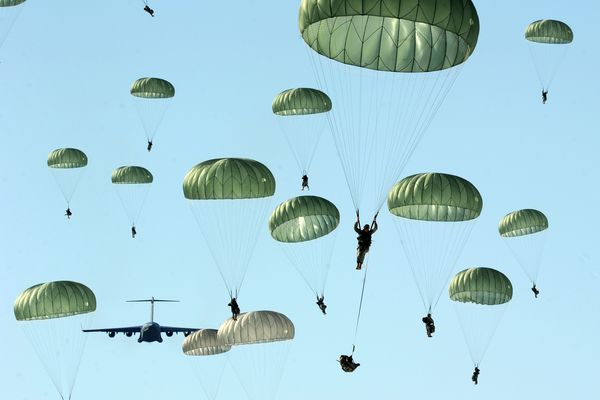 OPINION: Military contributes to Alaska's prosperity, but Alaskans should remember that's not the military's mission. Pictured: Paratroopers of the 4th Brigade Combat Team (Airborne) 25th Infantry Division float to earth during training in April 2013 at the Malamute Drop Zone on Joint Base Elmendorf Richardson.