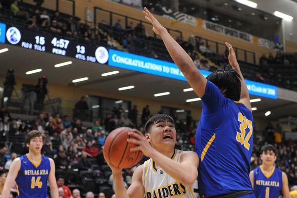 Talon Shaishnikoff, of Unalaska, goes up for the shot against Conrad Hudson, of Metlakatla, in the 2A boys Alaska State basketball tournament at the UAA Alaska Airlines Center in Anchorage, Alaska on Saturday, March 17, 2018. (Bob Hallinen / ADN)