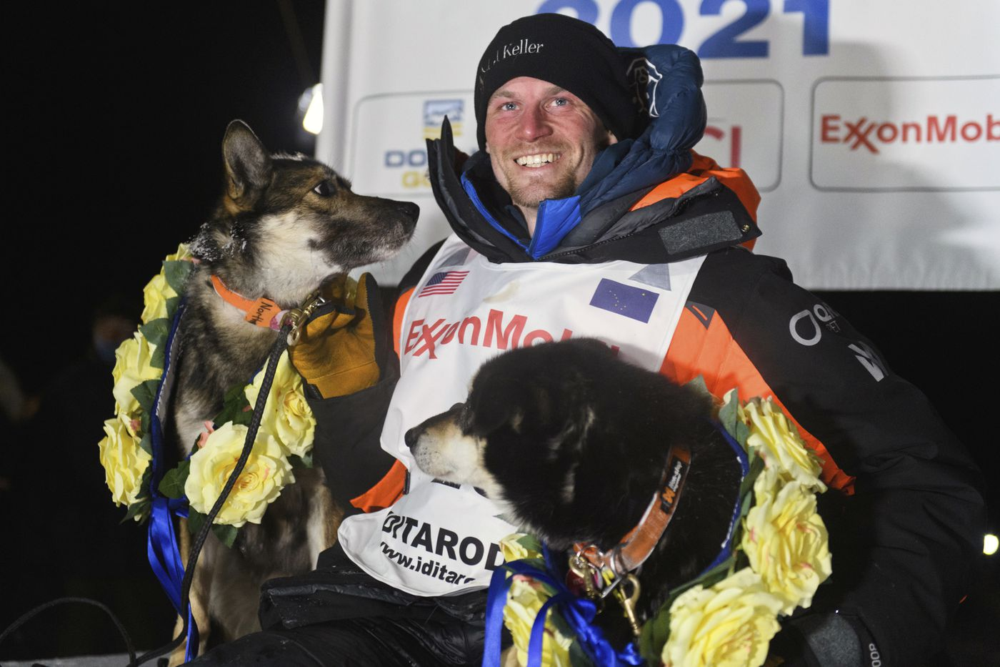 Dallas Seavey poses with his dogs after winning the Iditarod Trail Sled Dog Race race near Willow early Monday. (Marc Lester/ADN)