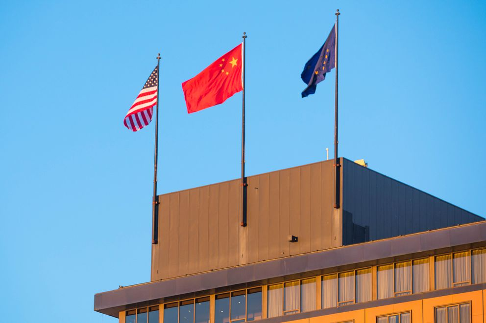 The Chinese flag flies between the U.S. and Alaska flags atop the Hotel Captain Cook where Gov. Bill Walker met with Chinese president Xi Jinping on Friday, April 7, 2017. (Loren Holmes / Alaska Dispatch News)