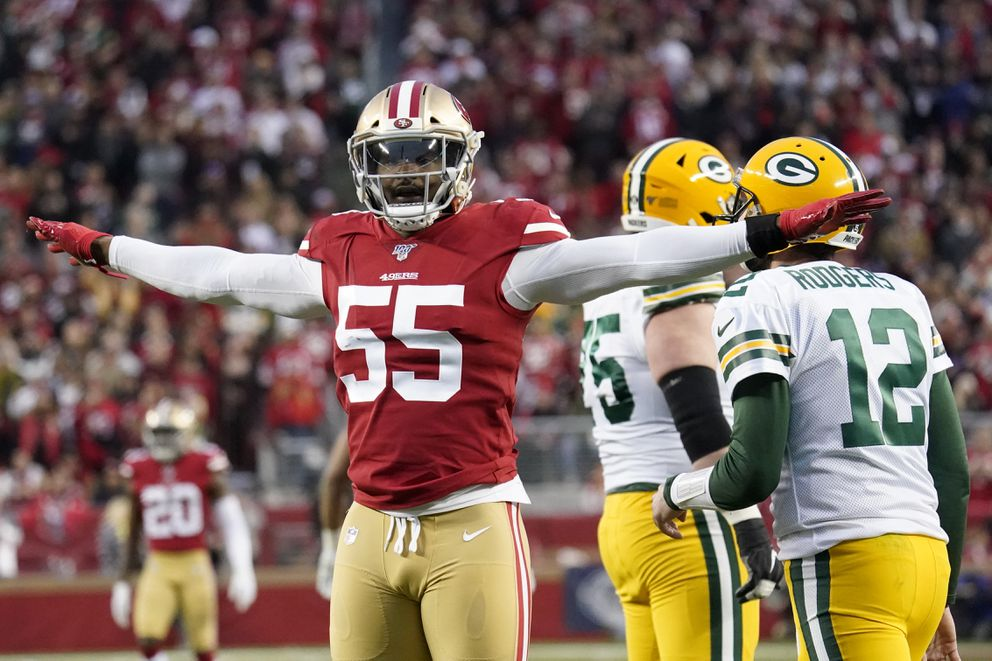 San Francisco 49ers defensive end Dee Ford (55) gestures next to Green Bay Packers quarterback Aaron Rodgers (12) during the first half of the NFL NFC Championship football game Sunday, Jan. 19, 2020, in Santa Clara, Calif. (AP Photo/Tony Avelar)