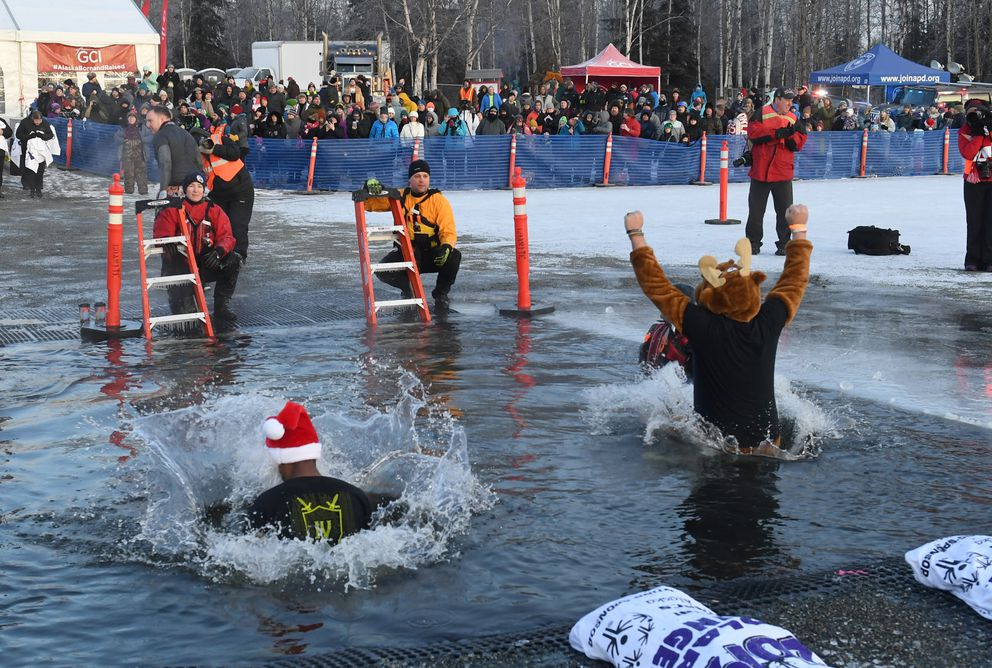 Participants jumped into the icy waters of Goose Lake in Anchorage, AK on Saturday, December 21, 2019 during the 11th annual Special Olympics Polar Plunge. (Photo by Bob Hallinen)