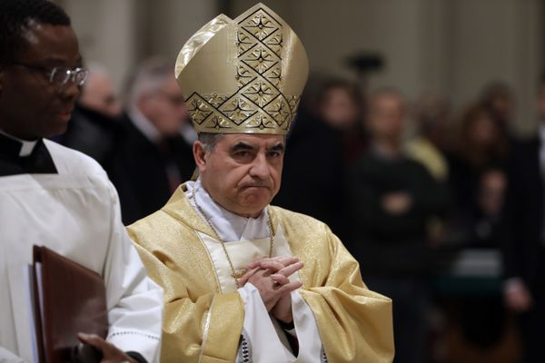 FILE - In this Feb. 9, 2017 file photo, Mons. Giovanni Angelo Becciu presides over an eucharistic liturgy, at the St. John in Latheran Basilica, in Rome. The powerful head of the Vatican's saint-making office, Cardinal Angelo Becciu, has resigned from the post and renounced his rights as a cardinal amid a financial scandal that has reportedly implicated him indirectly. (AP Photo/Gregorio Borgia, File)