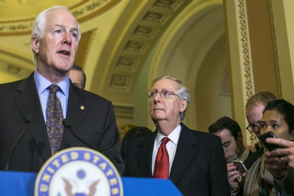 FILE -- Senate Majority Leader Mitch McConnell (R-Ky.), center, listens as Sen. John Cornyn (R-Texas) speaks after a weekly Republican policy luncheon, on Capitol Hill in Washington, Jan. 31, 2017. In one of the clearest signs of the abrupt shift of power in Washington, the Republican-controlled Congress has been rolling back environmental regulations set in place by the Obama administration, one after another. (Al Drago/The New York Times)