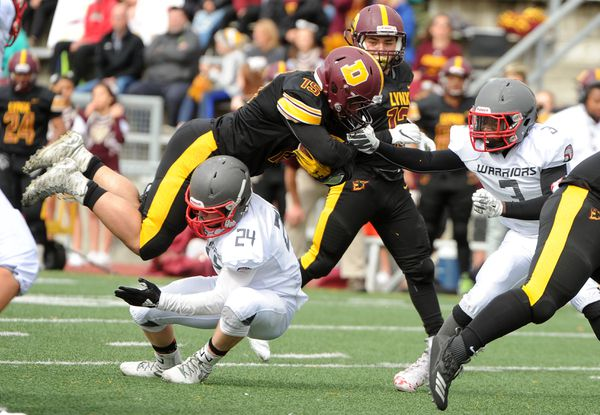 Colton Lindquist, of Wasilla, upends Dimond ball carrier Gio Young at Dimond High in Anchorage, AK on Saturday, Aug 11, 2018. (Bob Hallinen / ADN)