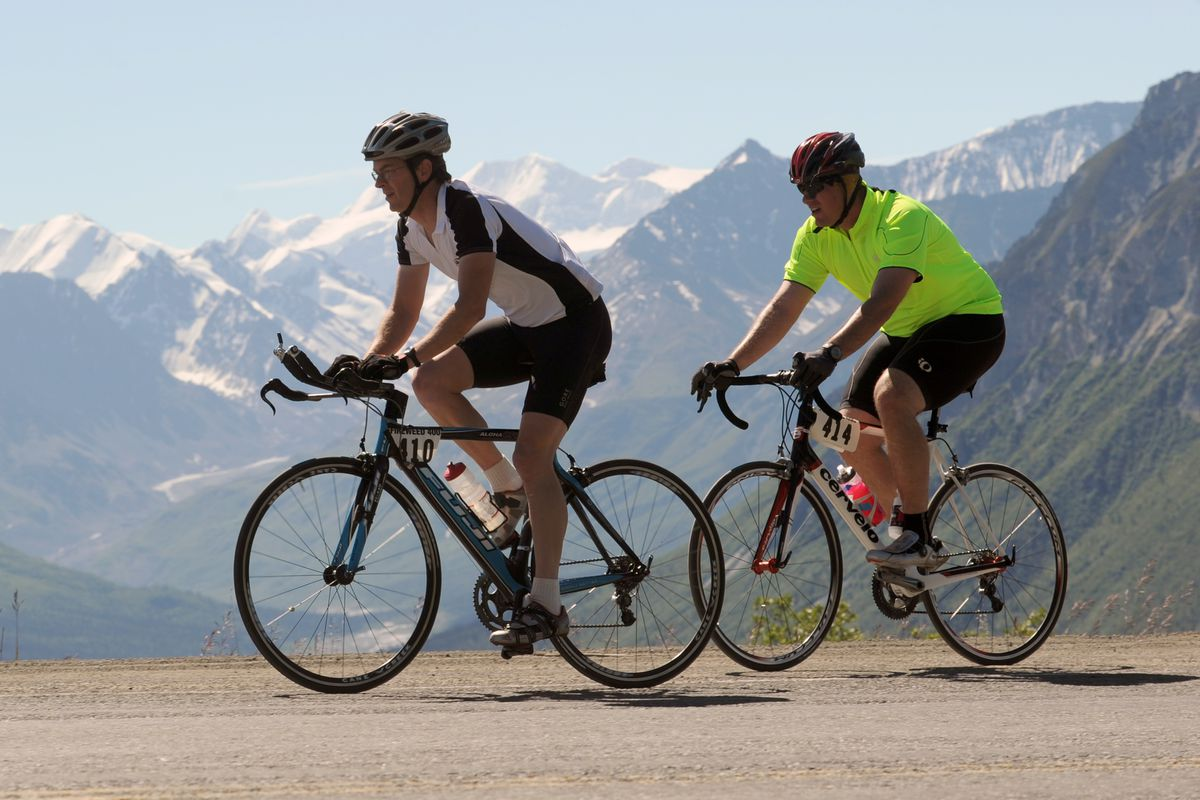 Joe Pollock, left, and Trevor Jones set out in the 400 solo race of the Fireweed 400 bicycle event in2010 on the Glenn Highway. The two-day race to Valdez and back starts and finishes at Sheep Mountain Lodge, where most of the races begin Saturday. (Erik Hill / ADN archive 2010)
