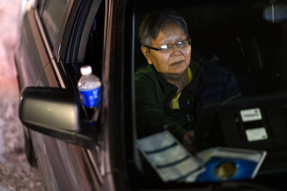 Eva Booth watches a livestream of the bingo call as she plays in a vehicle at Tudor Bingo Center. (Marc Lester / ADN)