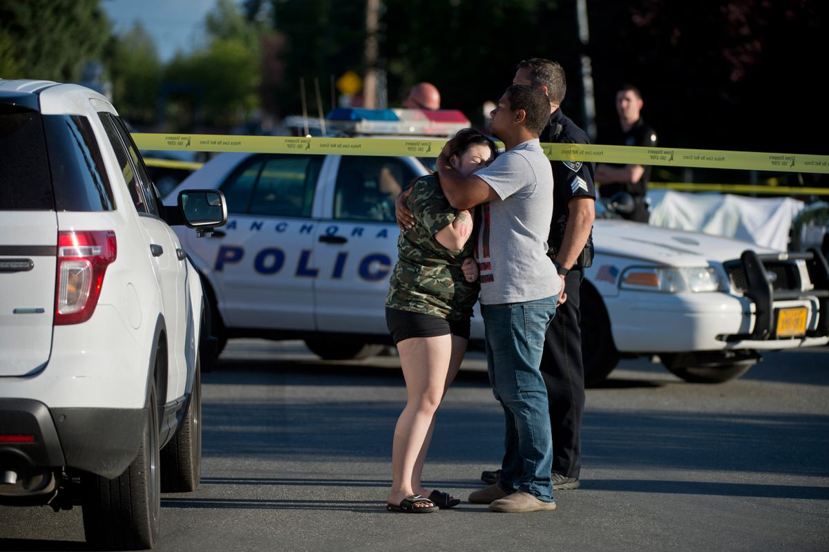 A woman cries as Anchorage police investigate a shooting death on North Bliss Street in Anchorage on July 20, 2018. (Marc Lester / ADN)