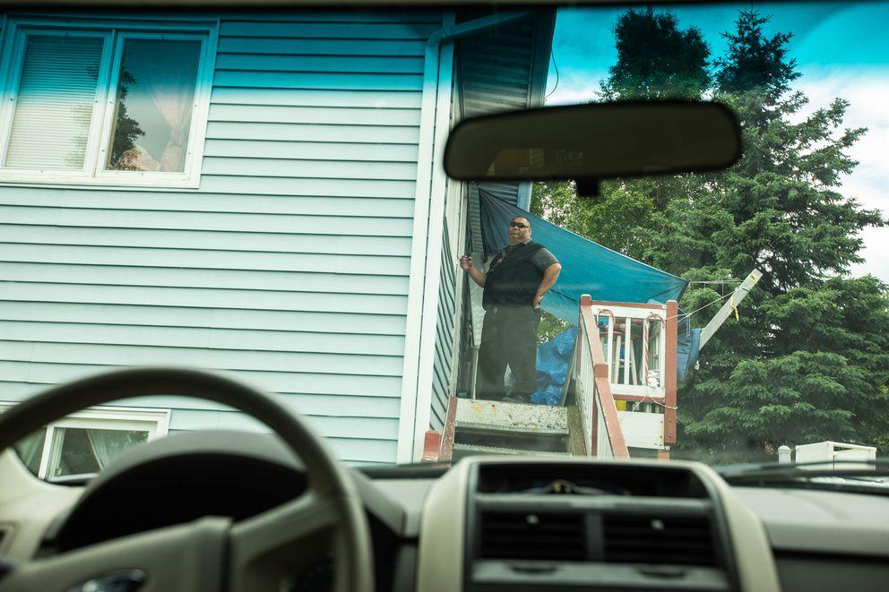 Numiamalefua Failagi knocks on a client's door Thursday, June 28, 2018. (Loren Holmes / ADN)