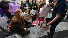 Anchorage airport crowd cheers return of Seward swimmer Lydia Jacoby, Alaska's newest Olympian
