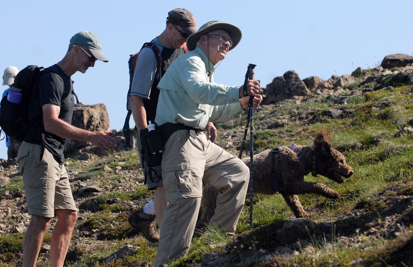 Doug Wooliver, left, and Steve Wooliver hike alongside their father, George Wooliver, near the top of Flattop Mountain in Chugach State Park on Friday, July 5, 2019. (Matt Tunseth / ADN)