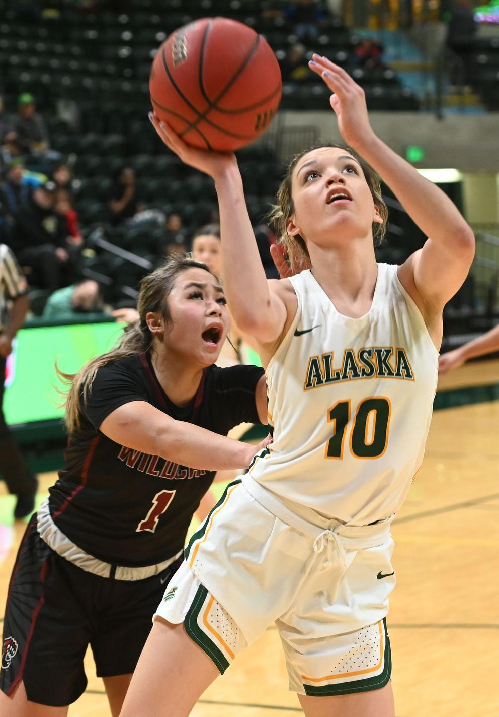 UAA's Yazmeen Goo gets the bucket and the foul by Central Washington defender Brianna Phiakhamngon. (Bill Roth / ADN)