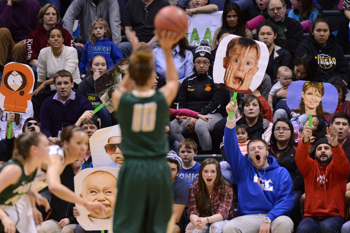 UAA fans attempt to distract on opponent at the free throw line. (ADN archive)