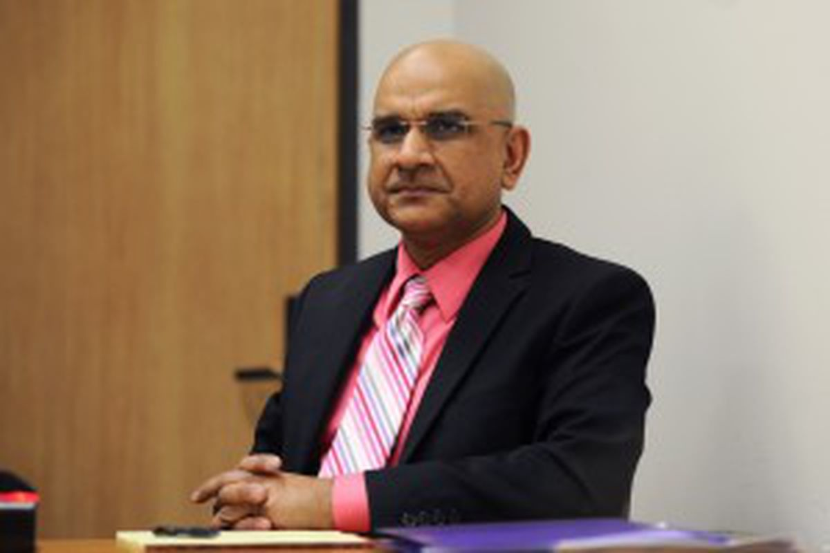 Dr. Mahmood Ahmad awaits the start of his appeals hearing on Thursday morning, May 26, 2016, in the Atwood Building in Anchorage. (Erik Hill / Alaska Dispatch News)